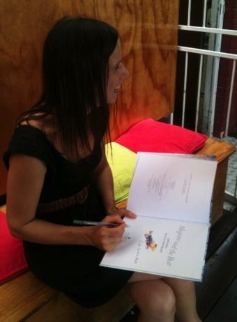 Irma Gold signing books at Avid Reader
